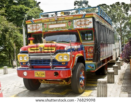 "MEDELLIN, COLOMBIA - MAY 2: ""Chiva"" truck parked on ""Pueblito Paisa"" on May 2, 2010 in Medellin, Colombia. Chivas are  very typical transportation vehicles in Colombia."
