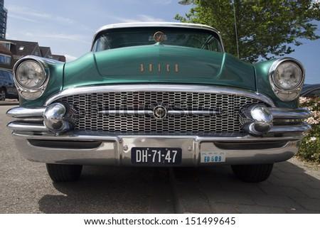 MEDEMBLIK, NETHERLAND, -JULY 28 : Buick Roadmaster 1955 during a oldtimer show on July 28, 2013 in Medemblik, Netherlands.  - stock photo