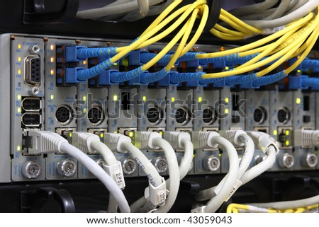 Media Converters. Fiber Optic cables connected to an optic ports and UTP Network cables connected to an Fast/Giga ethernet ports. Data Network Hardware Concept. - stock photo