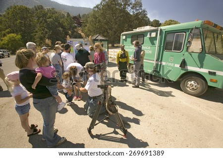 Media crews and forest service personnel meet with locals during Ventura County's Day Fire of 2006