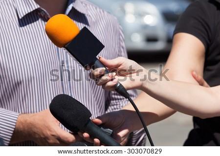 Media interview. Microphone. - stock photo