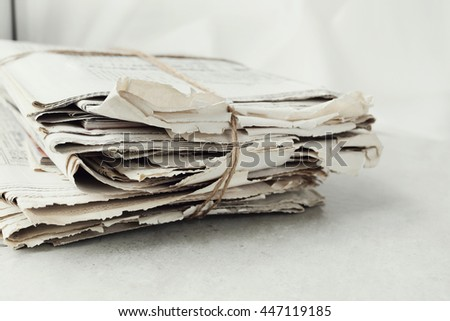 Media. Newspaper on the table - stock photo