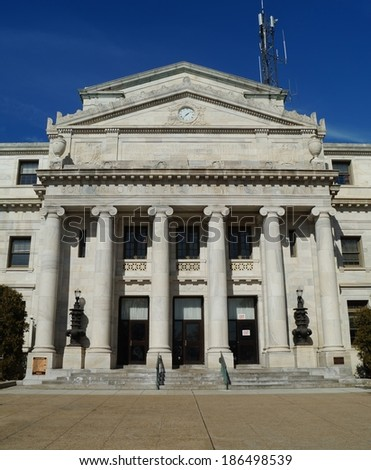MEDIA, PENNSYLVANIA - March 6, 2014: Built in 1850 the Delaware County Courthouse is a U.S. historical landmark site featuring the architecture of a typical American courthouse. - stock photo