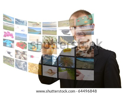Media room, young man choosing channel on digital screen. All used images are mine. - stock photo