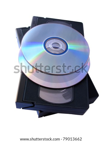 Media storage: two DVD and two VHS tapes. Old versus new technology