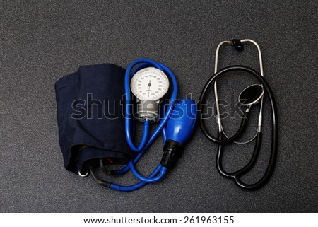 medic instruments for measuring blood pressure - stethoscope and tonometer - stock photo