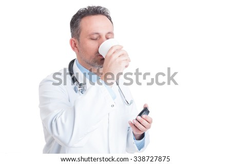Medic or doctor drinking coffee from disposable cup as break and pause concept - stock photo