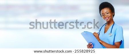 Medical african american doctor  woman over blue background. - stock photo