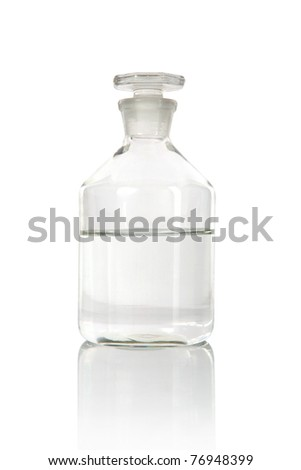 Medical alcohol bottle with liquid inside-half full - stock photo
