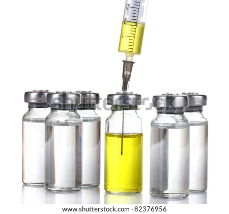 medical ampoules and syringe isolated on white - stock photo