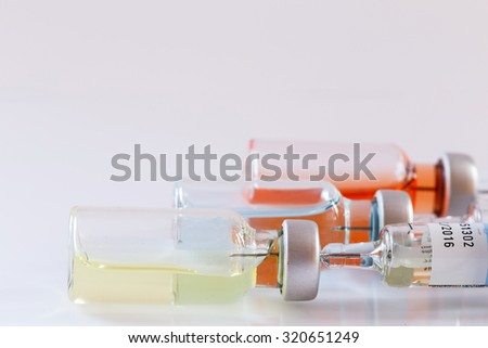 Medical ampoules and syringe on white background.Vaccination. - stock photo