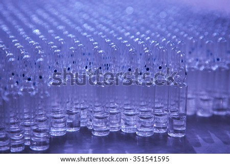 Medical ampules on a blue background, selective focus - stock photo