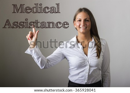 Medical Assistance - Beautiful girl touching text on transparent surface - horizontal image - stock photo
