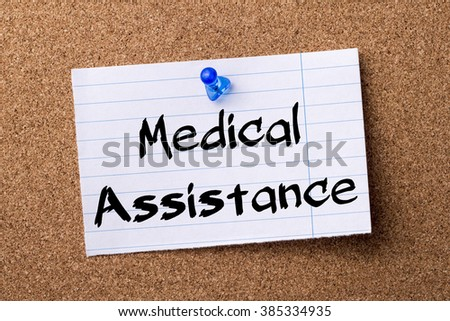 Medical Assistance - teared note paper pinned on bulletin board - horizontal image - stock photo