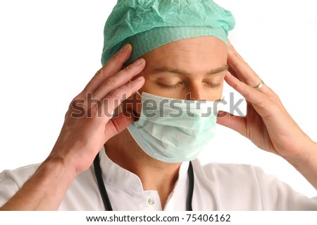 Medical assistant with a stethoscope around his neck having an headache