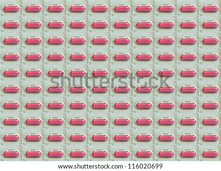 Medical Background Texture Of Red Pills In Blister Pack - stock photo