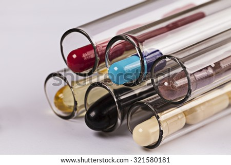 Medical background with pills and test tube pill pills medical capsule capsules drug drugs test tube pill pills medical capsule capsules drug drugs test tube pill pills medical capsule capsules drug  - stock photo