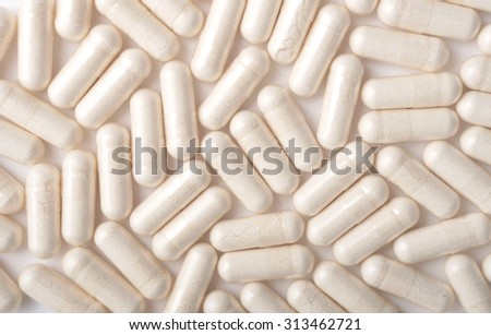 Medical background with white capsules - stock photo