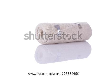 medical bandage roll on white - stock photo