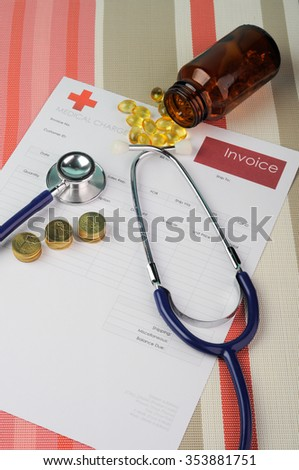 Medical Bill with Stethoscope and Coins.