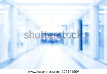 medical blurred background, empty hospital corridor in neon blue light