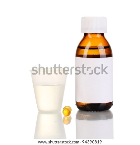 Medical bottle with jigger and tablets isolated on white - stock photo