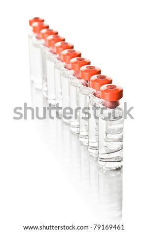 Medical bottles in the row isolated on white - stock photo