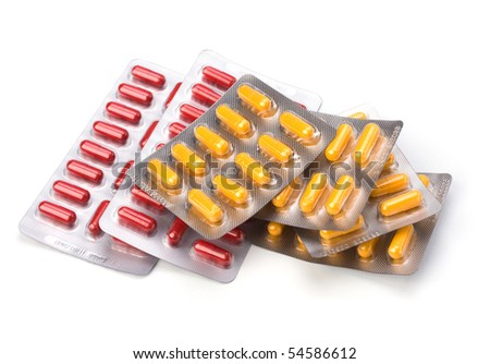 medical capsules isolated on white - stock photo