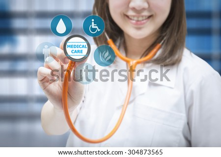 medical care concept with doctor holding stethoscope - stock photo