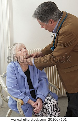 Medical check up to  elderly woman at her home - stock photo