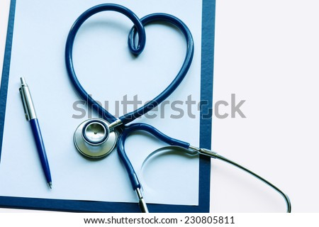 Medical clipboard and stethoscope - stock photo