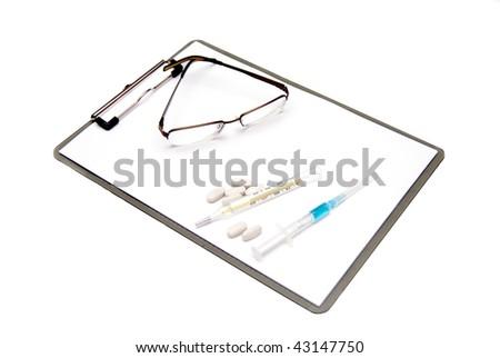 Medical clipboard, glasses and syringe isolated on white background - stock photo