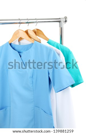Medical clothing on hunger isolated on white - stock photo