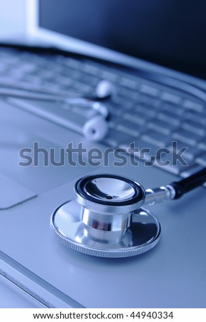 Medical computer and stethoscope - stock photo