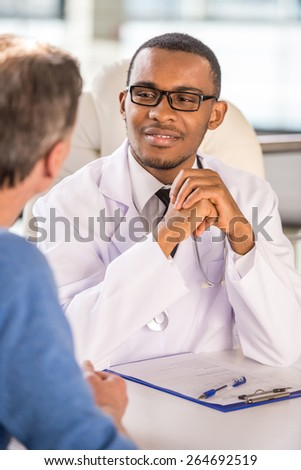 Medical concept. Doctor talking to his male patient. - stock photo