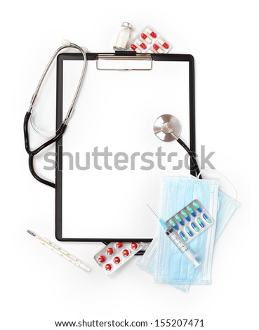 Medical concept : empty clipboard with stethoscope, pills and syringe isolated on white background
