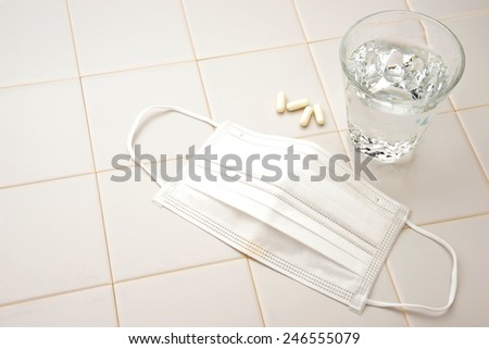 Medical concept, mas, capsules and glass of water
