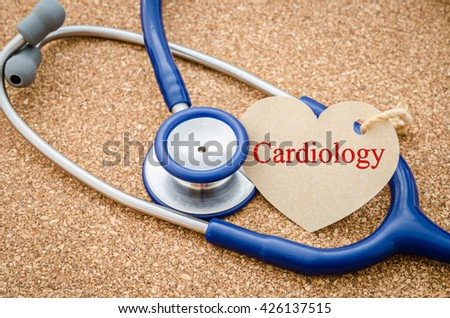 Medical conceptual image with CARDIOLOGY words and stethoscope on wooden background. - stock photo