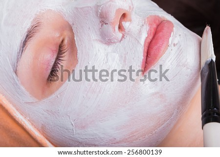 Medical cosmetic procedure. Mikronidling. Beautician performs Dermaroller procedure.young beautiful woman having an injection mesotherapy.cosmetic procedures in spa clinic.