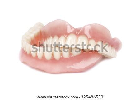 Medical denture on white background - stock photo