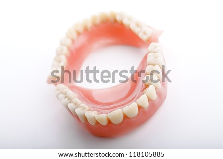 medical denture smile jaws teeth on white background - stock photo