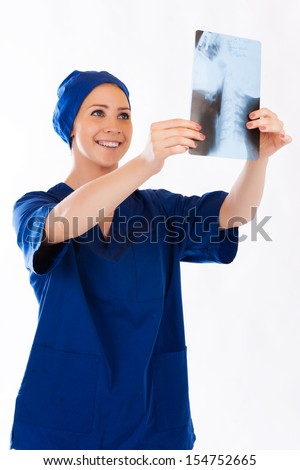 Medical doctor analysing x-ray photography isolated on white background - stock photo