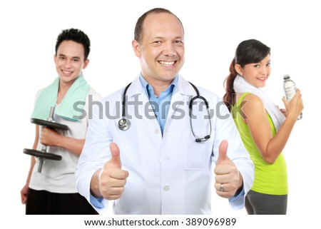 Medical doctor and people doing exercise at the background. Isolated on white - stock photo