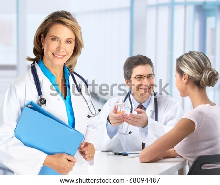 Medical doctor and young couple patients. - stock photo