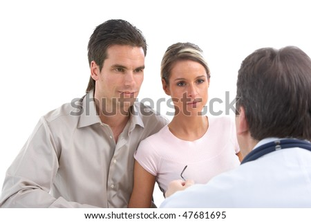 Medical doctor and young couple patients. Isolated over white background