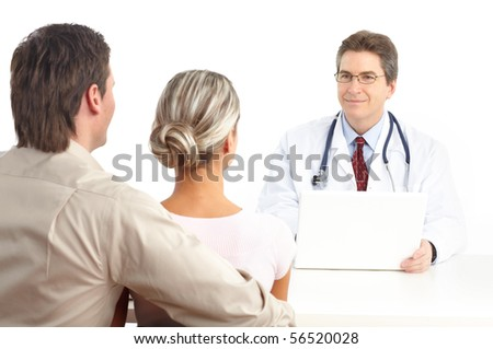 Medical doctor and young couple patients. Isolated over white background - stock photo