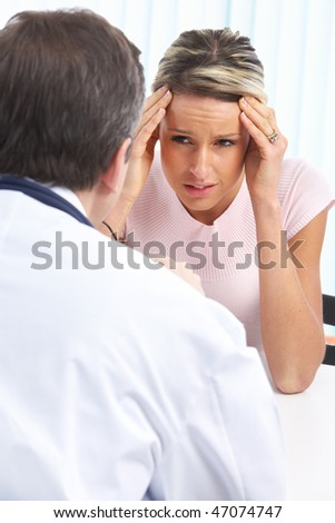 Medical doctor and young woman patient. - stock photo