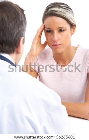 Medical doctor and young woman patient. Isolated over white background - stock photo
