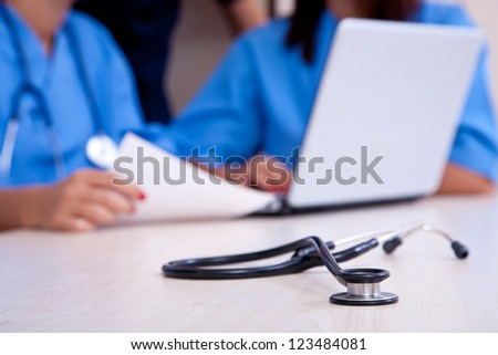 medical doctor at hospital with laptop and stethoscope, shallow - stock photo