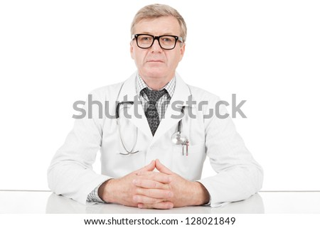 Medical doctor his hands above table - stock photo